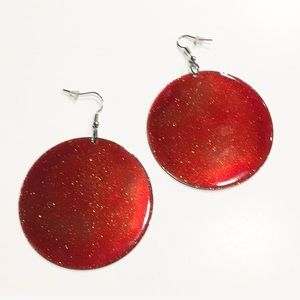 Round red shimmering circle is earrings NWT